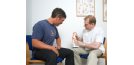 Osteopath communicating with new patient