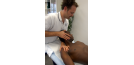 Male osteopath treating male