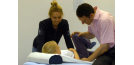 Male osteopath treating female child