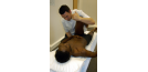 Male osteopath with male patient