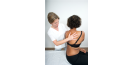 Female osteopath with female back