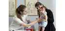 Female osteopath with mother and baby 2