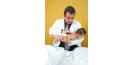 Male osteopath and baby