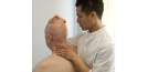 Male osteopath and elderly man