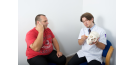 Male osteopath with male patient - skull