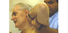 Male osteopath and middle aged man - back 2