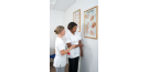 Osteopath and student with chart