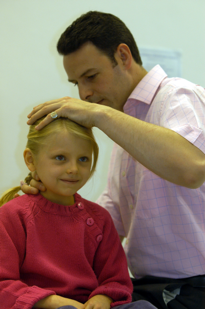 Male osteopath with female child
