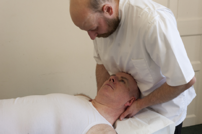 Male osteopath and middle aged man