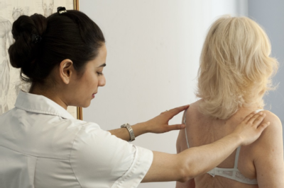 Female osteopath and elderly lady 2