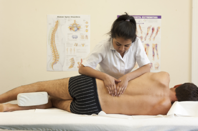 Female osteopath and male back 4