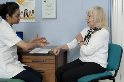 Female osteopath with elderly woman 4