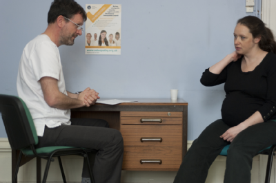 Male osteopath consultation with pregnant woman 2