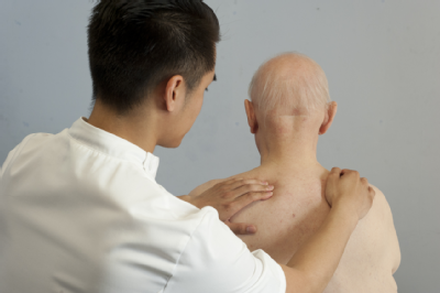 Male osteopath and elderly man 2