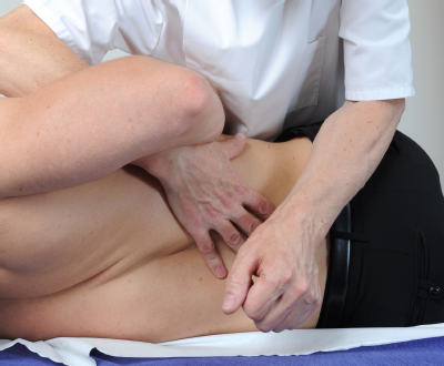 Male osteopath with male back 4