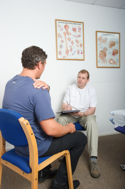 Male osteopath with male patient 2