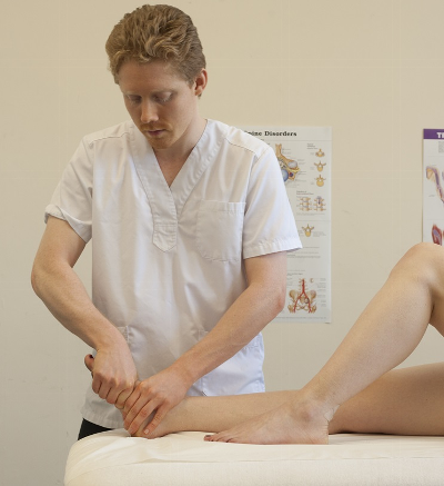 Male osteopath with woman's feet 2
