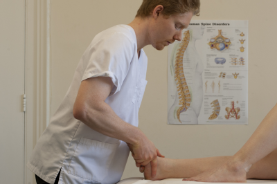 Male osteopath with woman's feet