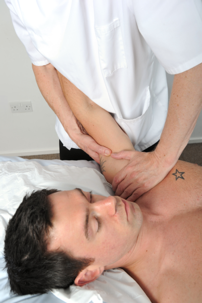 Osteopath and male patient