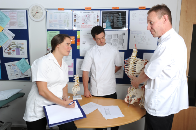 Osteopath and students with skeleton